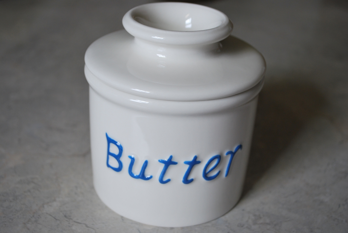 Your Butter Bell crock will hold one stick (1/2 cup) of butter. Pack butter firmly into the cup of the lid. Fill only 1/4 of the bottom cup with cold water. Make sure the water is high enough to create a seal when the lid is replaced. Replace lid and storage is complete. The butter can remain fresh for up to 30 days with proper maintenance. No refrigeration necessary.